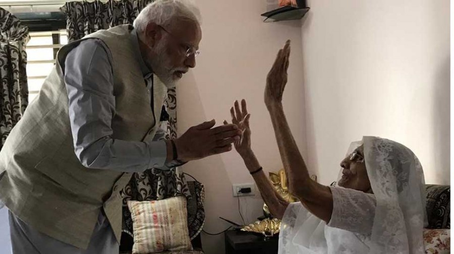 PM Modi meets his mother to take her blessings before casting vote in Ahmedabad