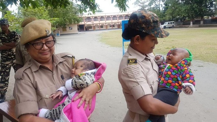 Assam police women hold babies while their mothers take exam, wins Hearts on Twitter