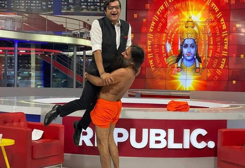 Ramdev lifts Arnab after performing yoga during interview; pic surfaces