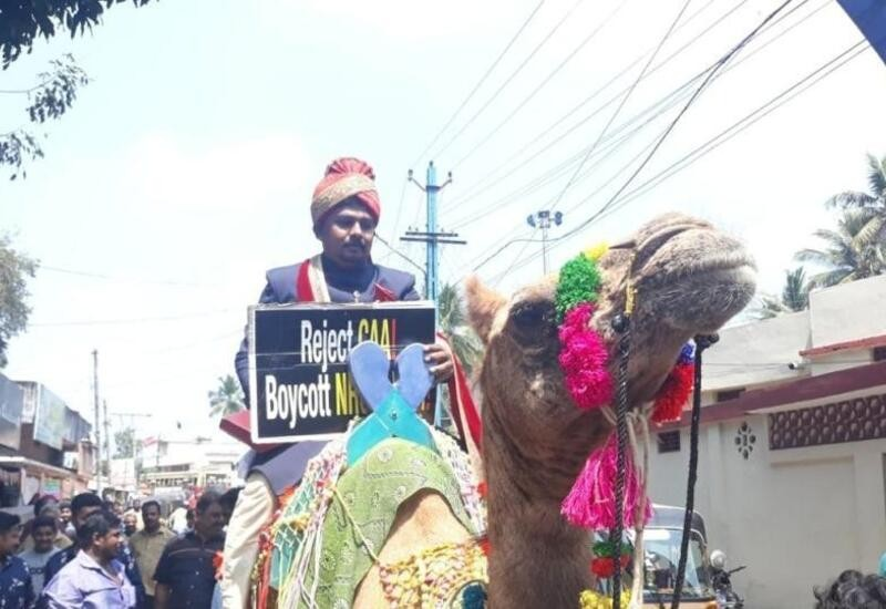 Kerala man came for his wedding on camel holding anti-CAA poster