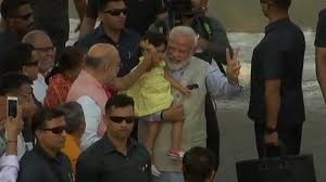 PM Modi votes in Gujarat, plays with Amit Shah's granddaughter as crowd cheers