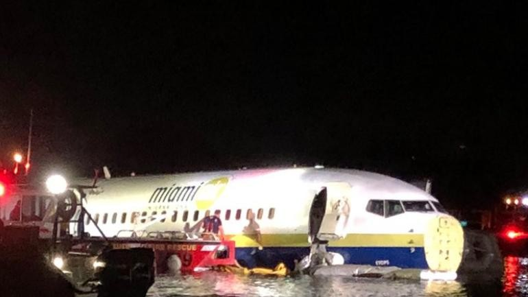 Boeing 737 jet skids off runway, slides into Florida river with 136 on board