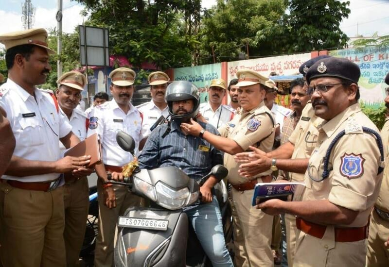 Hyderabad Police gives helmets instead of challans to traffic violators