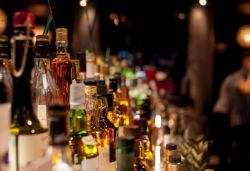 Liquor stocks surge even as Sensex falls 2,000 points as liquor stores re-open