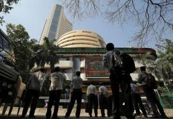 Nifty hits record high at 12,311, Sensex surges by 300 points