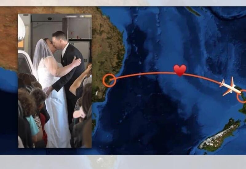 Couple gets married at 37,000 feet on flight between Australia and New Zealand