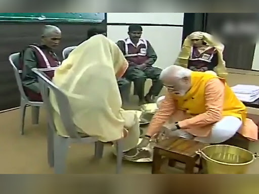 PM-KISAN launch Updates: Modi washes feet of sanitation workers, felicitates them at Kumbh