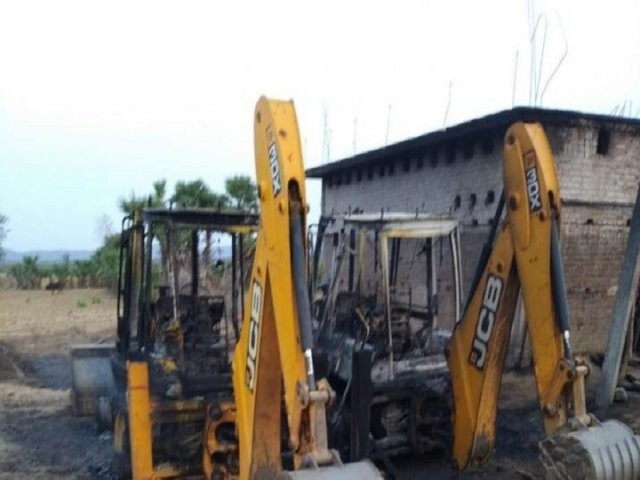 Naxals torch four vehicles engaged in road construction work in Gaya