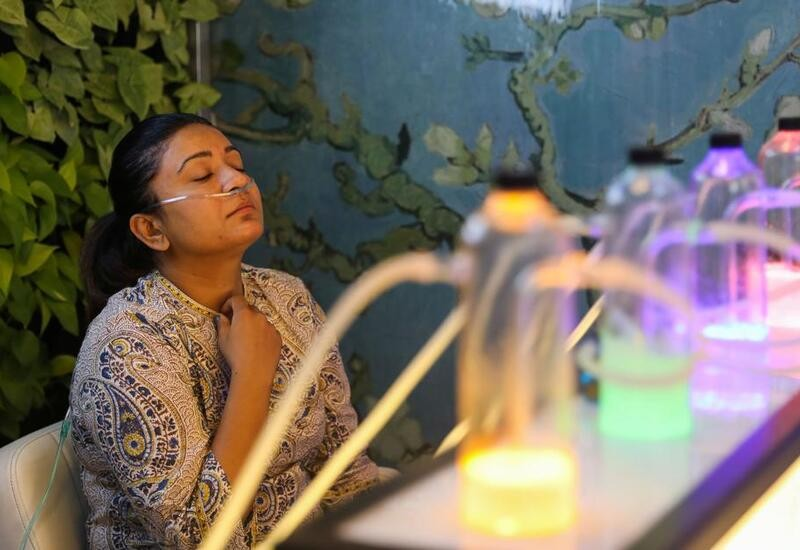 As Delhi pollution levels soar, customers throng an 'oxygen bar' for a breath of fresh air