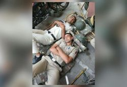 Picture of two policemen sleeping on ground after their duty goes viral