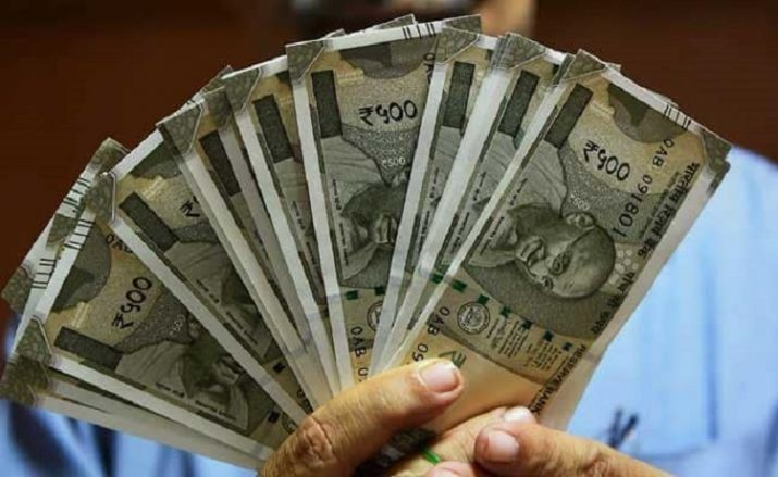 Rupee slips 8 paise to 69.73 against US dollar in early trade