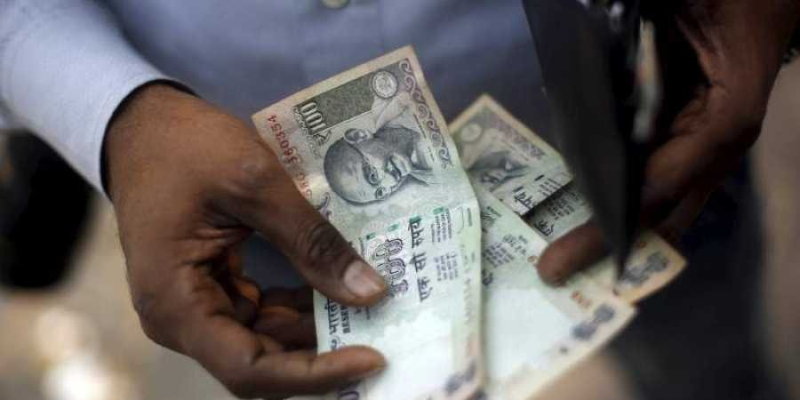 Rupee opens marginally higher to 69.21 vs US Dollar post RBI policy decision