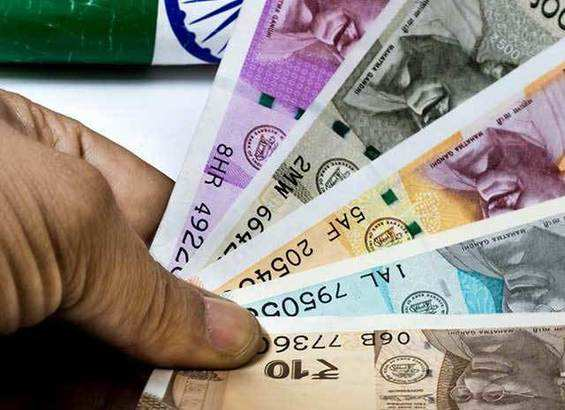 Rupee opens 12 paise higher at 71.66 against dollar in Early Trade