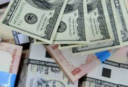 Rupee open at 71.29 vs friday's close of 71.19 against dollar