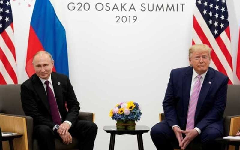 Smirking Trump jokes to Putin: don't meddle in US election