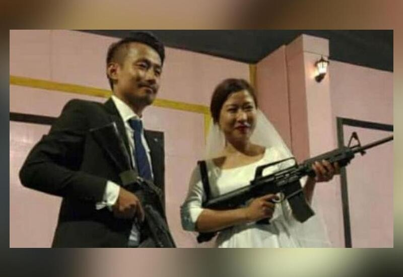 Naga rebel leaders' son, bride pose with assault rifles at their wedding